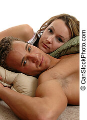 Time Together - A loving young couple laying on the floor...