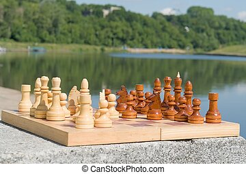 chessboard - the chessboard with figures with river at...