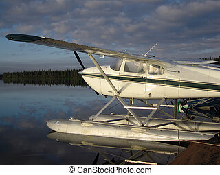 Float plane on lake - Float plane on northern Alberta lake.