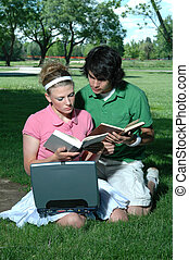Couple Studying - A young couple studying together outdoors...