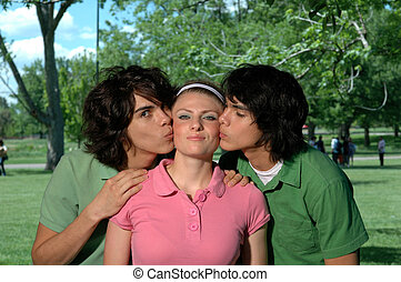 HappyGirl - A happy girl getting kissed by two twin brothers