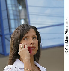 Business communications - Portrait of a businesswoman using...