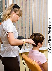 Hair stylist working on a client