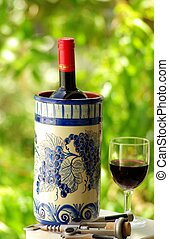 bottle of red wine - Glass and bottle of red wine produced...
