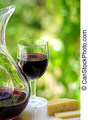 red wine with cheese - Glass and bottle of red wine with...