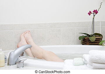 Bath series. Feet II - Bathtime. Girl\\\'s feet sticking out...