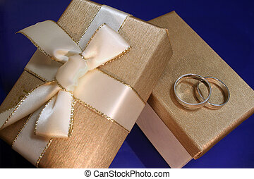 Wedding Rings - A pair of wedding bands on an exquisite...