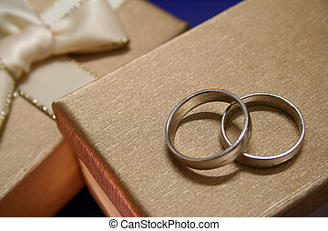 Wedding Rings - A pair of wedding rings on top of exquisite...