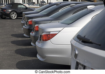 Car dealership 5 - Row of brand new cars at dealership lot