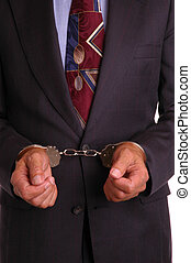 Businessman in handcufffs - Businessman in suit with hands...