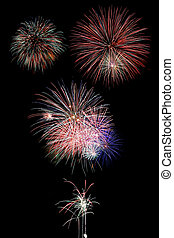 Fireworks over Black - Firework display at night with black...
