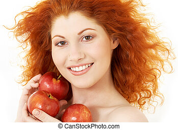 happy redhead with red apples