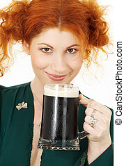 st patricks day - redhead in green dress with a mug of irish...