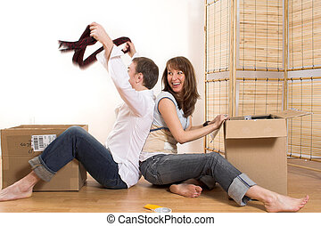 couple moving in appartment - happy couple moving in new...