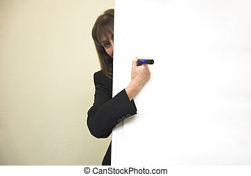 Bashful businesswoman - Business woman hiding behind blank...