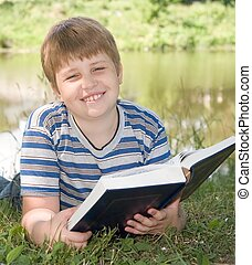boy reads a book