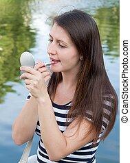 put on lipstickrn - young woman put on lipstick