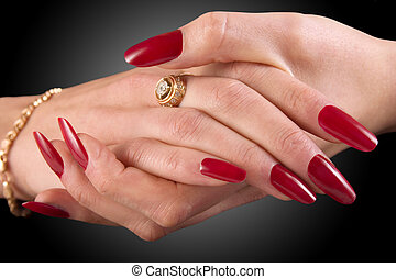 Manicure - Close-up of female hands on a black background