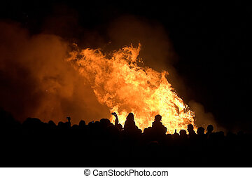 silhouettes of people over bonfire - silhouettes of people...