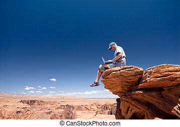 Freedom - USA. Arizona. Page. Horseshoe Bend. Man with...