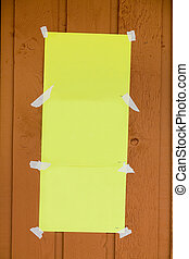 Announcement - blank yellow paper stick on outside wall