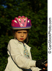 Girl With Bycicle Helmet and Forest in Background