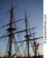 Masts in sunset - Ship\\\'s mast and rigging at sunset in...