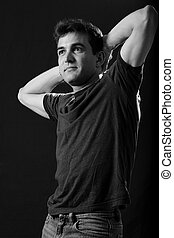 Man stretching - Handsome brunette young man with hands...