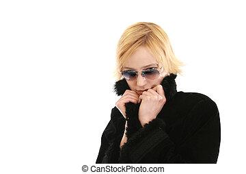 Blond woman in long black