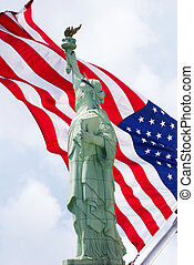 Liberty - The Statue of Liberty with an American flag