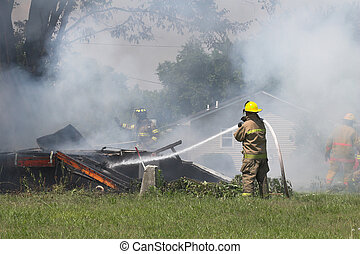 house fire 7 - Fire fighters look for victums in debree of...