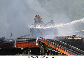 house fire 14 - Fire fighters look for victums in debree of...