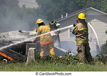 house fire 11 - Fire fighters look for victums in debree of...