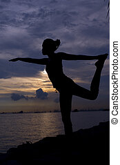Balance and Stretch - Silhouette of woman doing stretching...