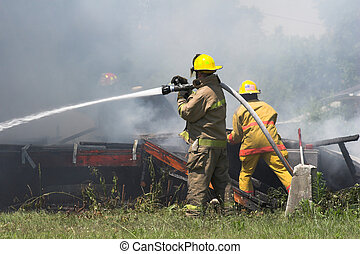 house fire 6 - Fire fighters look for victums in debree of...