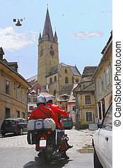 Travelers - Image of two bikers traveling in an old European...
