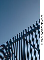 security gates - steel security gates against blue sky