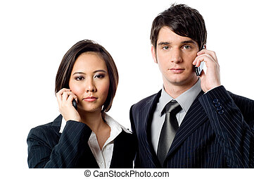 Business Communications - Two young business people with...