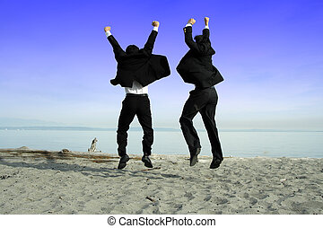 Happy businessmen - Two businessmen jumping and celebrating...