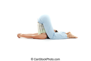 halasana plow pose - sporty girl practicing halasana plow...