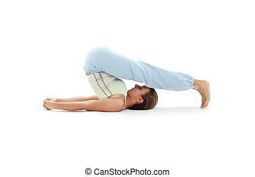 halasana plow pose 2 - sporty girl practicing halasana plow...