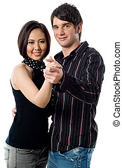 Young Couple Dancing - A young man and woman dancing...