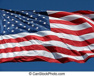 American Flag - A US flag waves on a clear day.