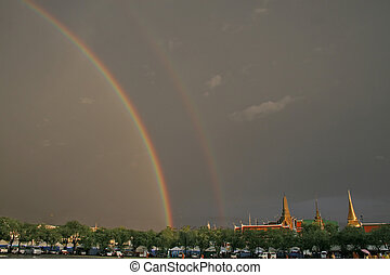 Rainbow over Grand Palace - The setting sun shines on the...