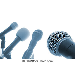 Press Conference Row Of Microphones With One In The...