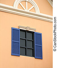 Blue Shades - A Pink building with dark blue shutters