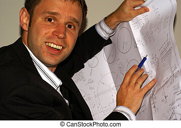 Happy engineer - architect / engineer man with plans in a...
