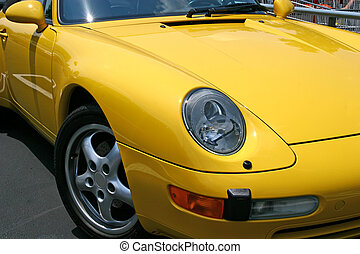 Bright Yellow Sports Car - A view of a bright yellow sports...
