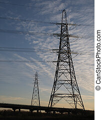 Power - Two electricity pylons \\\'silhouetted\\\' against...