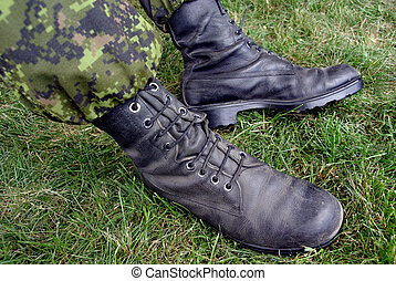 Combat Boots - Close up shot of military boots and fatigues